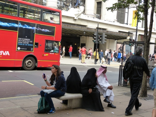 Oxford Street, London UK - notice women wearing burqa with face covering niqab
