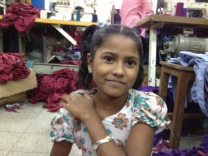 Meem, 9, at work in a Bangladesh garment factory