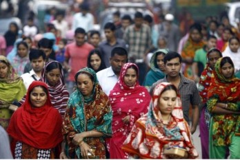 Bangladeshi garment workers arrive for work in Dhaka